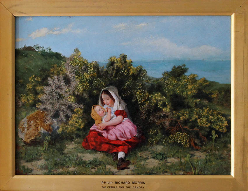 girl holding baby and canopy by the coast